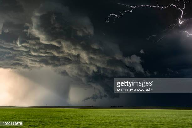 extreme thunderstorm moving at speed with lightning, nebraska. usa - dramatic landscape stock pictures, royalty-free photos & images