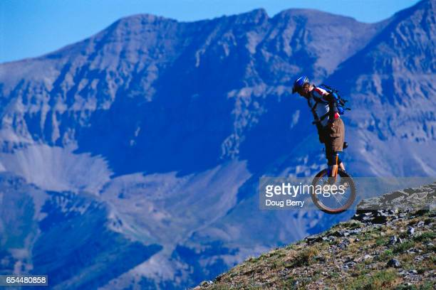 Extreme Unicyclist Riding Down Mountain