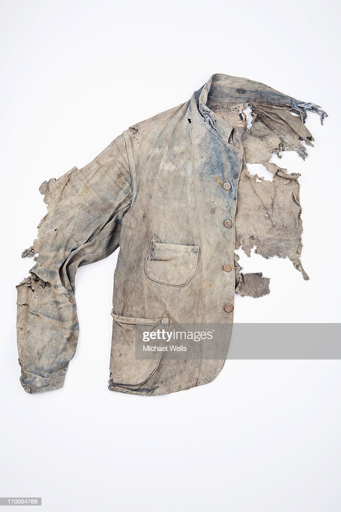 Extremely damaged denim jacket : Stock Photo