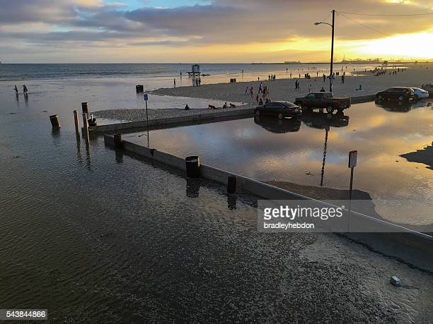 extremely high tide floods seal beach, ca - california flood stock photos and pictures