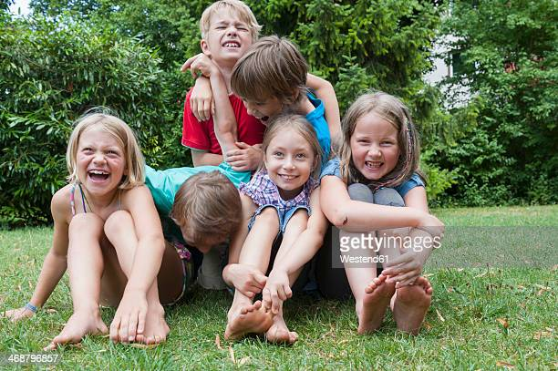 Exuberant children in garden