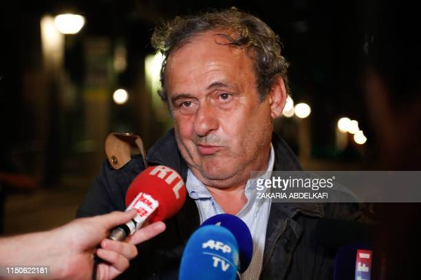 Ex-UEFA chief Michel Platini, flanked by his lawyer William Bourdon, talks to the media as he leaves the Central Office for Combating Corruption and...