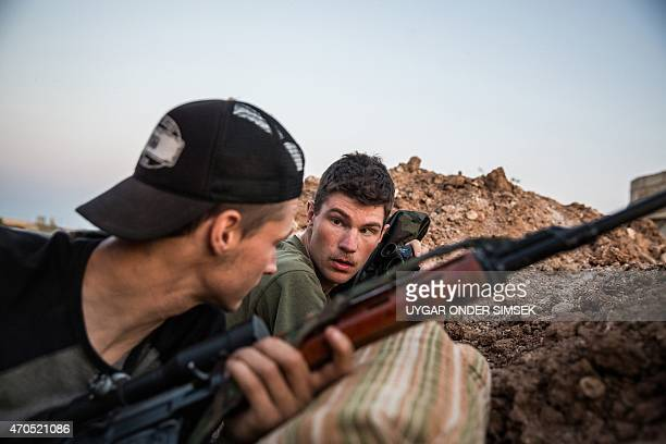 ExUS marines aged 23 and 24 from the US nicknamed by Kurdish fighters as Hewal Agir and Hewal Agit guard a position during clashes with Islamic State...