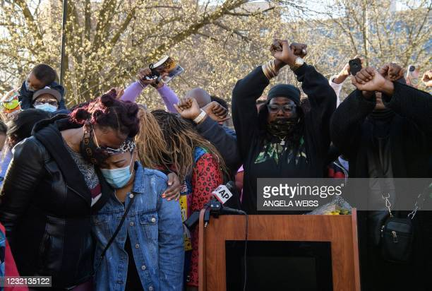 Ex-wife Tashera Simmons and fiancee Desiree Lindstrom hug while surrounded by friends of hospitalized rapper Earl Simmons, aka DMX, attend a prayer...