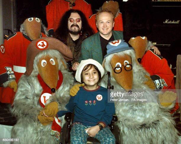 ExWizzard singer Roy Wood and song writer Mike Batt with Great Ormond Street Hospital invited guest Corinne Zammit age nine from Malta at a photo...