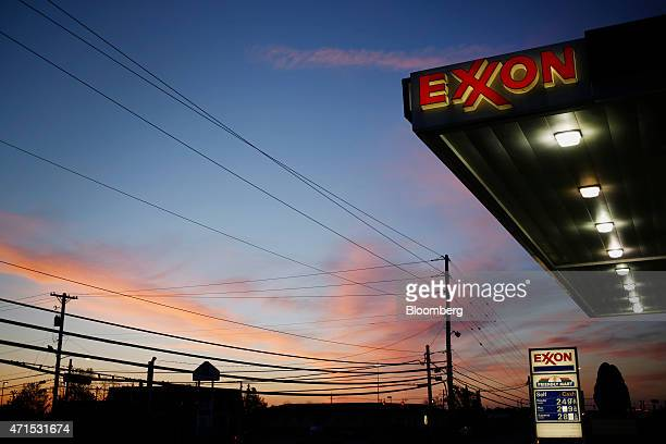 Exxon Mobil Corp signage is displayed at a gas station in Richmond Kentucky US on Wednesday April 29 2015 Exxon Mobil Corp is scheduled to release...