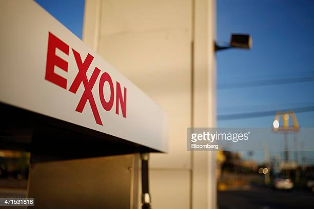 Exxon Mobil Corp signage is displayed on a fuel pump at a gas station in Richmond Kentucky US on Wednesday April 29 2015 Exxon Mobil Corp is...