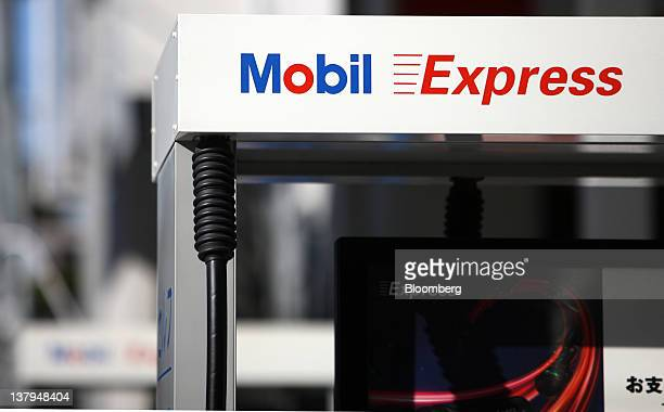 A Exxon Mobil Yugen Kaisha Mobil gas station stands in Tokyo Japan on Monday Jan 30 2012 TonenGeneral Sekiyu KK agreed to buy partner Exxon Mobil...