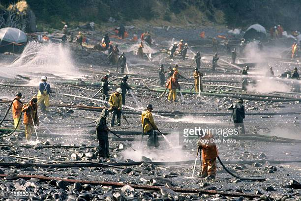 Exxon Valdez oil spill workers use pressure washers to wash oil from the beach at Smith Island on Alaska's Prince William Sound