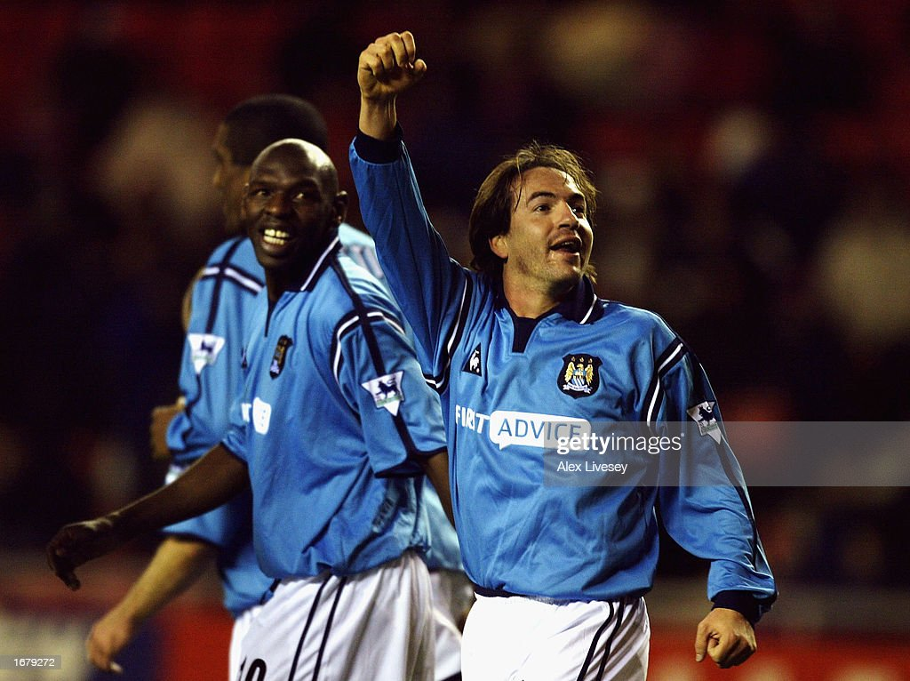 https://media.gettyimages.com/photos/eyal-berkovic-of-man-city-celebrates-shaun-goaters-goalduring-the-v-picture-id1679272