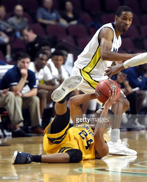 Eyassu Worku of the UC Irvine Anteaters grabs a loose ball against Torry Johnson of the Northern Arizona Lumberjacks during the 2017 Continental Tire...