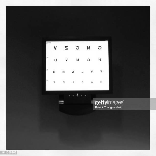 eye chart used for an eye exam - eye chart stock photos and pictures
