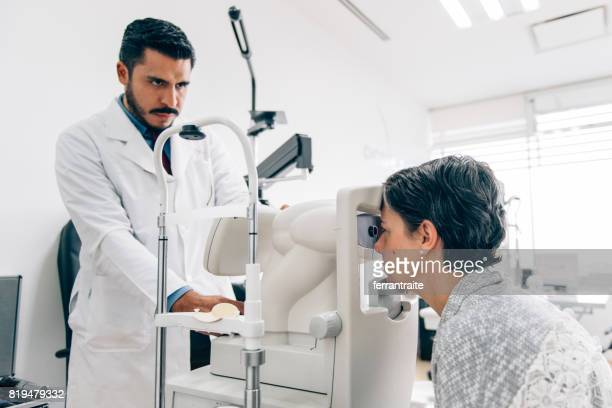 eye check up - retinal scan stock pictures, royalty-free photos & images