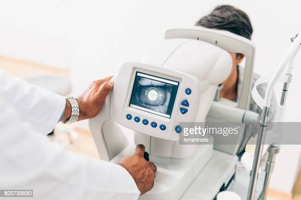 eye check up - optometry stock pictures, royalty-free photos & images