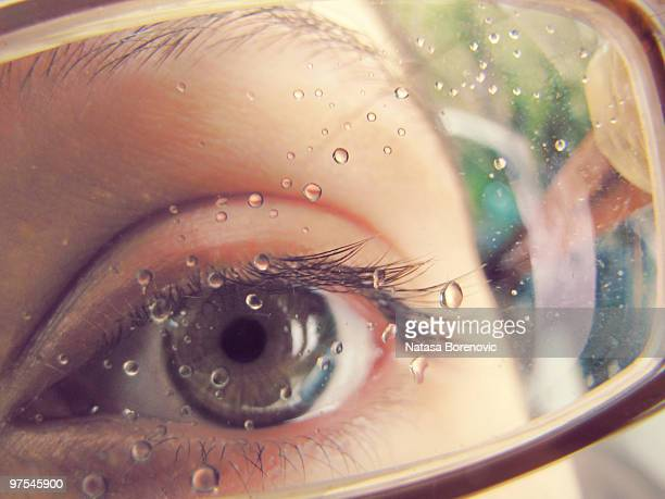 Eye close up with raindrops