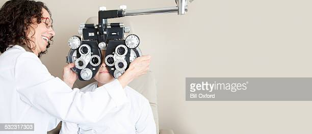 eye exam - optometry stock pictures, royalty-free photos & images