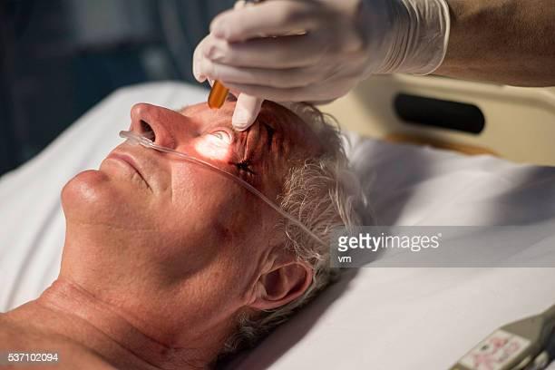 Eye examination with handheld lens
