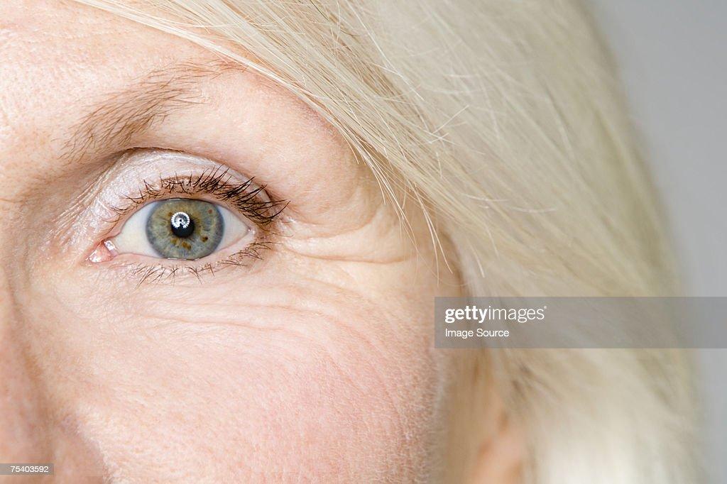 Eye of a senior woman : Stock Photo