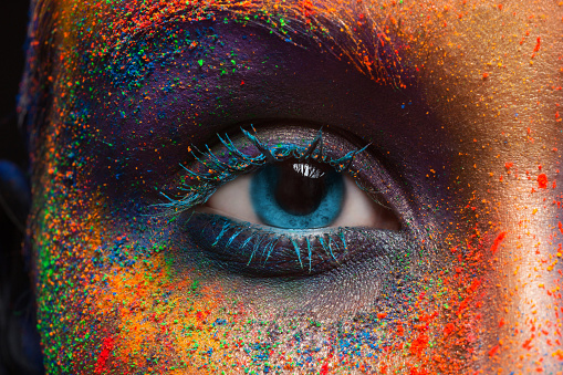Eye of model with colorful art make-up, close-up 814423752