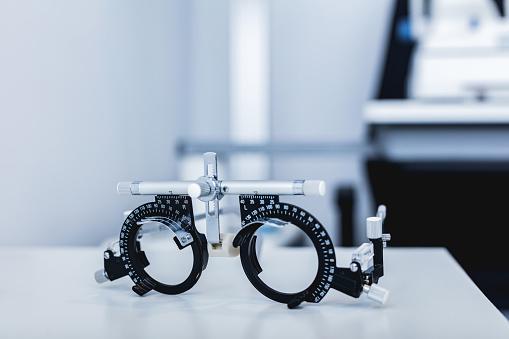 Eye test glasses at doctor's office. 1067130568