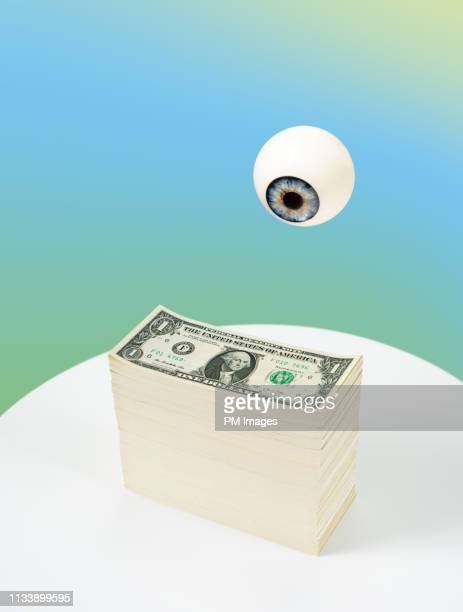 eye watching cash - big brother orwellian concept stock pictures, royalty-free photos & images