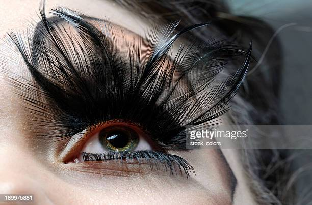 eye with feather eyelashes - gothic stock pictures, royalty-free photos & images