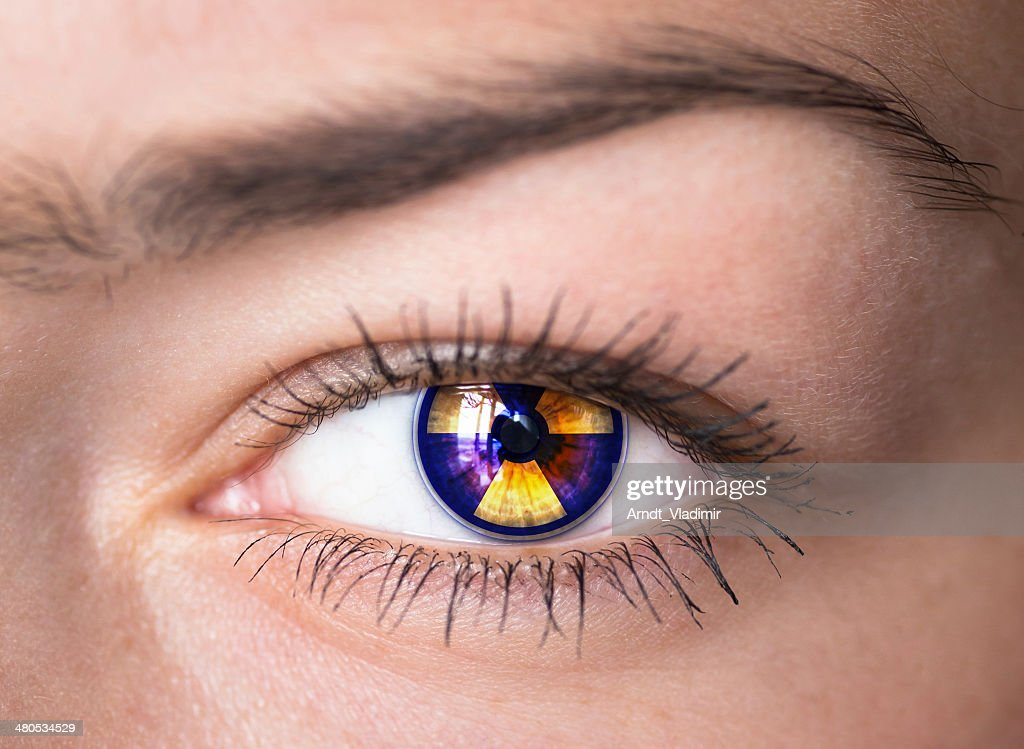 Eye with radiation symbol. : Stock Photo
