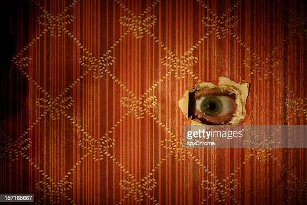 eyeball looking through wall - streaker stock pictures, royalty-free photos & images