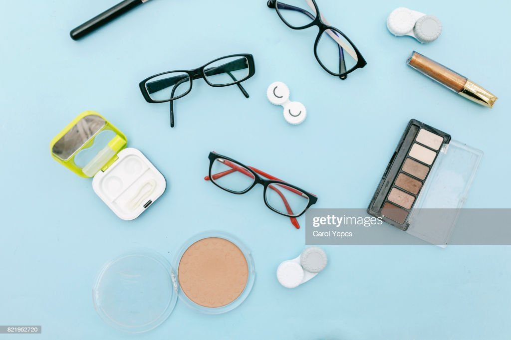eyeglasses and contact lenses  and make up.top view : Stock Photo