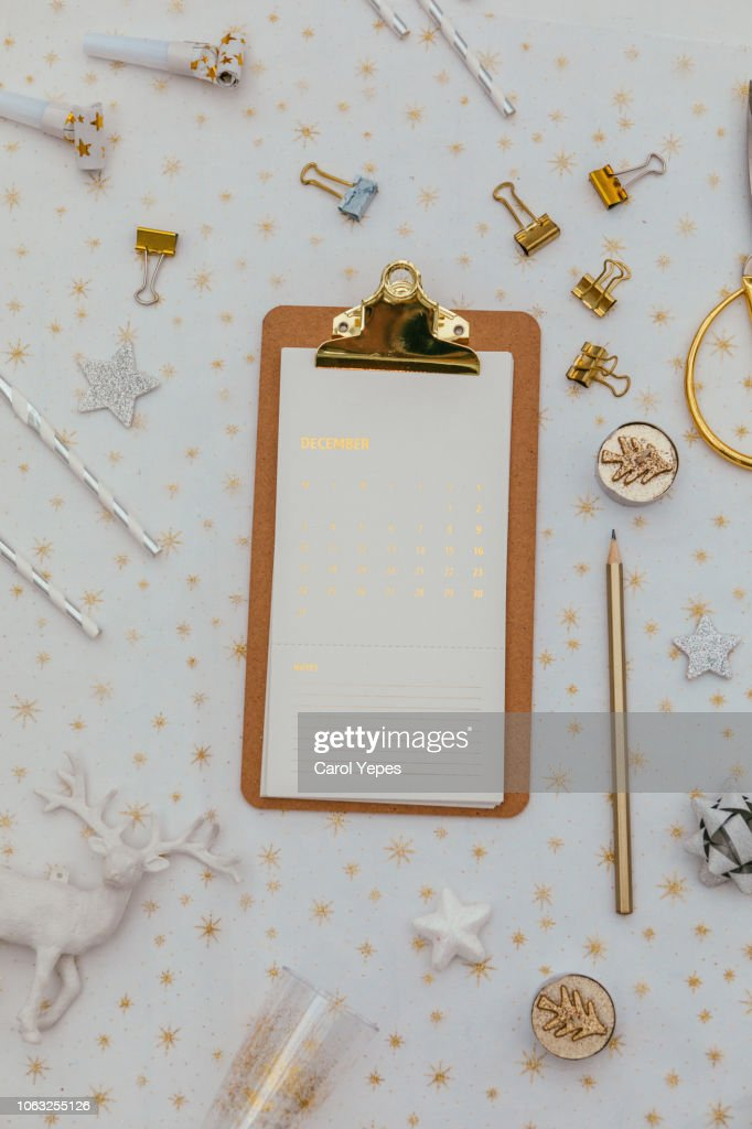 eyeglasses and golden clippboard on desktop : Stock Photo