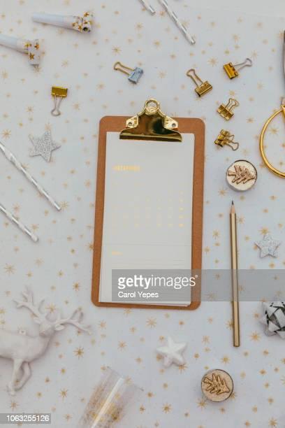 eyeglasses and golden clippboard on desktop
