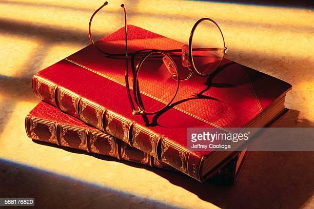Eyeglasses atop Books