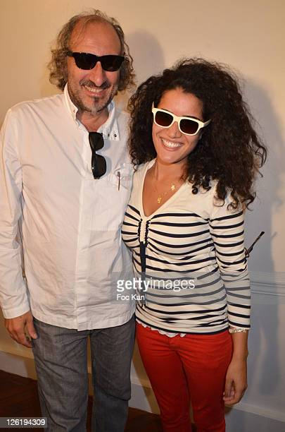 Eyeglasses designer Alain Mikli and actress Sabrina Ouazani attend the JeanPaul Gaultier Eyeglasses by Mikli Launch Cocktail at Mikli Flagship Store...