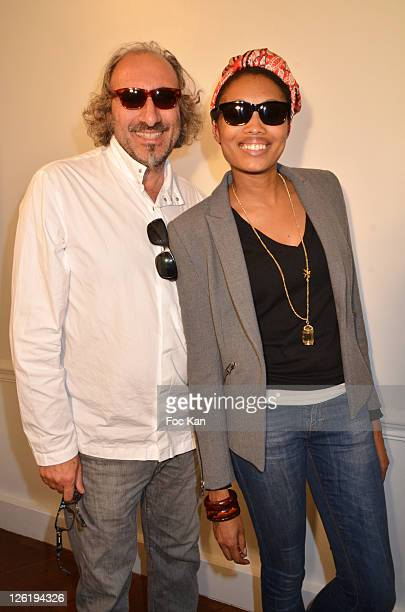 Eyeglasses designer Alain Mikli and singer Imany attend the JeanPaul Gaultier Eyeglasses by Mikli Launch Cocktail at Mikli Flagship Store St Peres on...