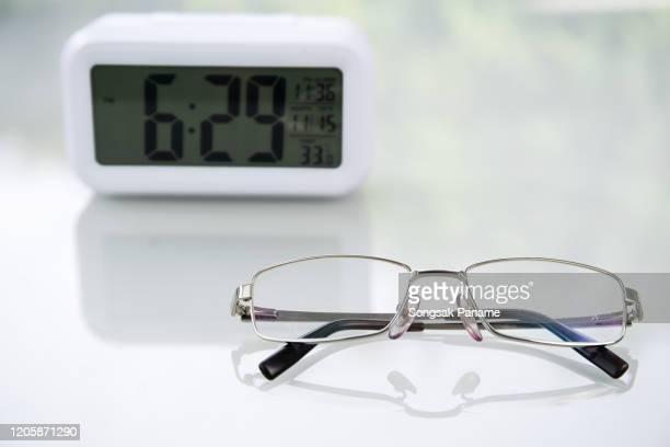 close up eyeglasses table at home