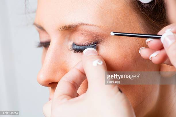 eyelash application - false eyelash stock pictures, royalty-free photos & images