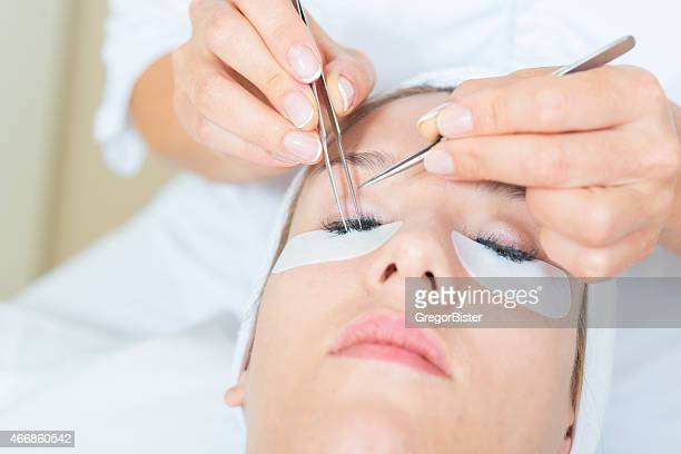 eyelash extensions - false eyelash stock pictures, royalty-free photos & images