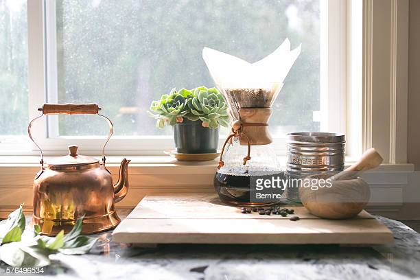 eye-level view of coffee and kettle and succulent - café moulu photos et images de collection