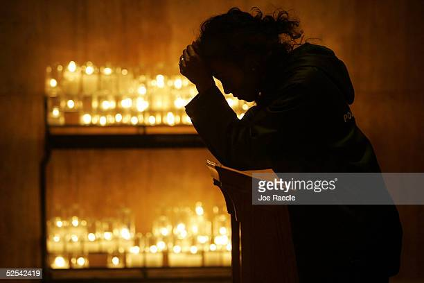 Eyerusalem Solomon of Tacoma Park Maryland prays for Pope John Paul II in the Basilica of the National Shrine of the Immaculate Conception March 31...
