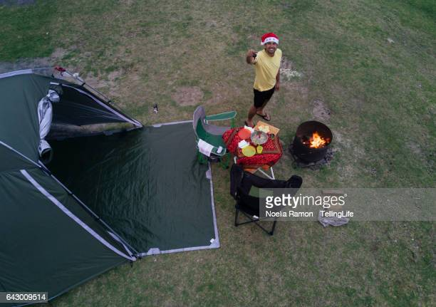 Eye's bird view of a man camping, with a fire and celebrating Christmas, Victoria, Australia