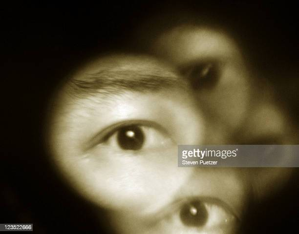 eyes looking through holes - film noir style stock pictures, royalty-free photos & images
