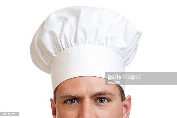 Eyes of a cook with white chef hat