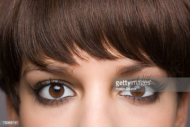 eyes of a young woman - brown eyes stock pictures, royalty-free photos & images