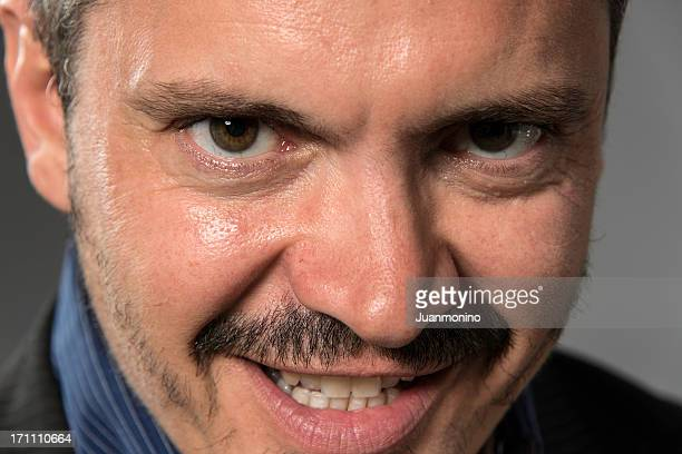 eyes of evil - ugly smile stock pictures, royalty-free photos & images