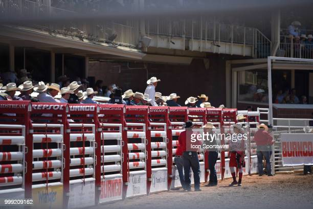 Eyes turn to the next saddle bronc rider before he comes out of the gates at the Calgary Stampede on July 14 2018 at Stampede Park in Calgary AB