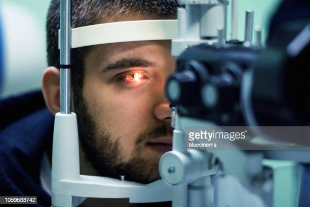 eyesight exam - medical laser stock photos and pictures