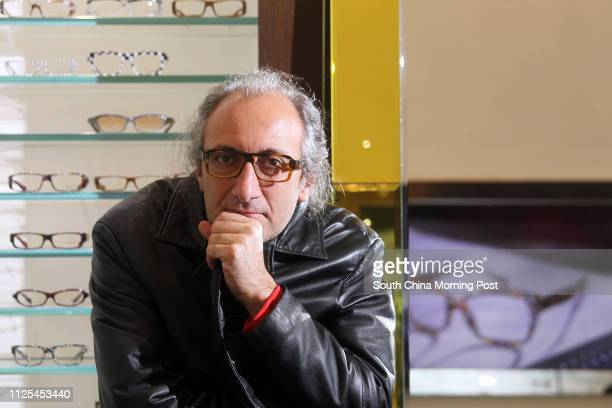 Eyewear designer Alain Mikli poses for photo at Central 12DEC12