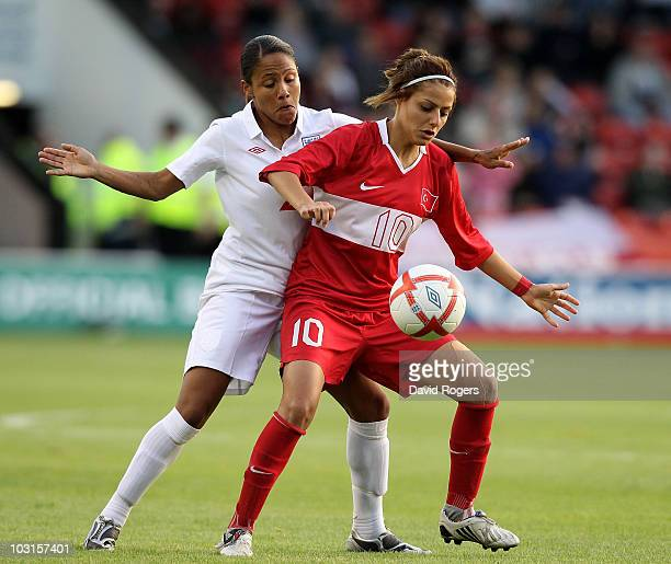 Eylul Elgalp of Turkey shields the ball from Alex Scott during the FIFA Womens World Cup Qualifiying match between England and Turkey at the Banks's...