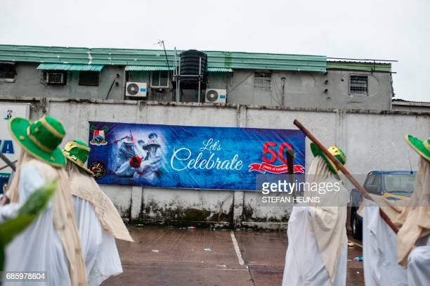 Eyo masqueraders arrive at the Tafawa Balewa Square in Lagos on May 20 2017 The whiteclad Eyo masquerades represent the spirits of the dead and are...