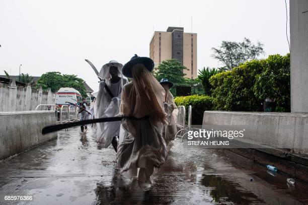 Eyo masqueraders dance as they arrive at the Tafawa Balewa Square in Lagos on May 20 2017 The whiteclad Eyo masquerades represent the spirits of the...